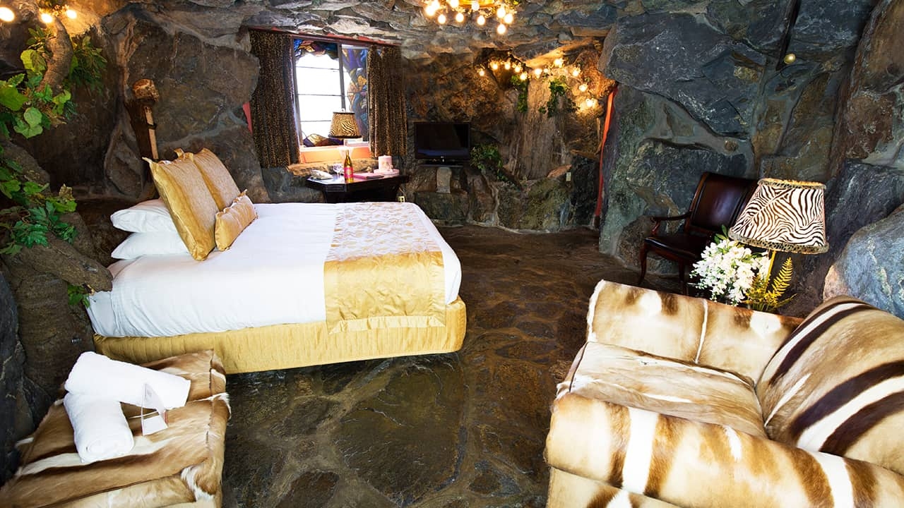 Caveman Room at the Inn, with rock floors and walls