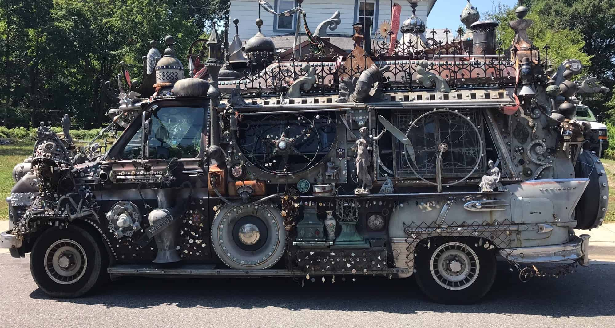 Art car van, fully adorned with metal items on exterior of vehicle