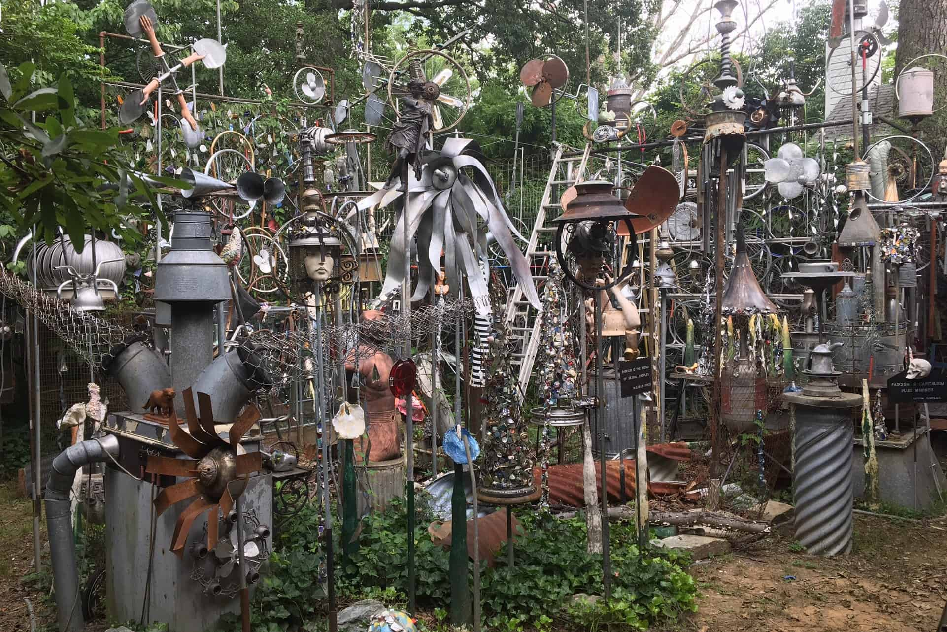Outdoor space at art house, lots of moving metal pieces all interacting together