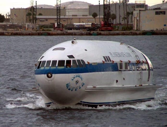 A plane that has been converted into a boat in the water at Port Everglades