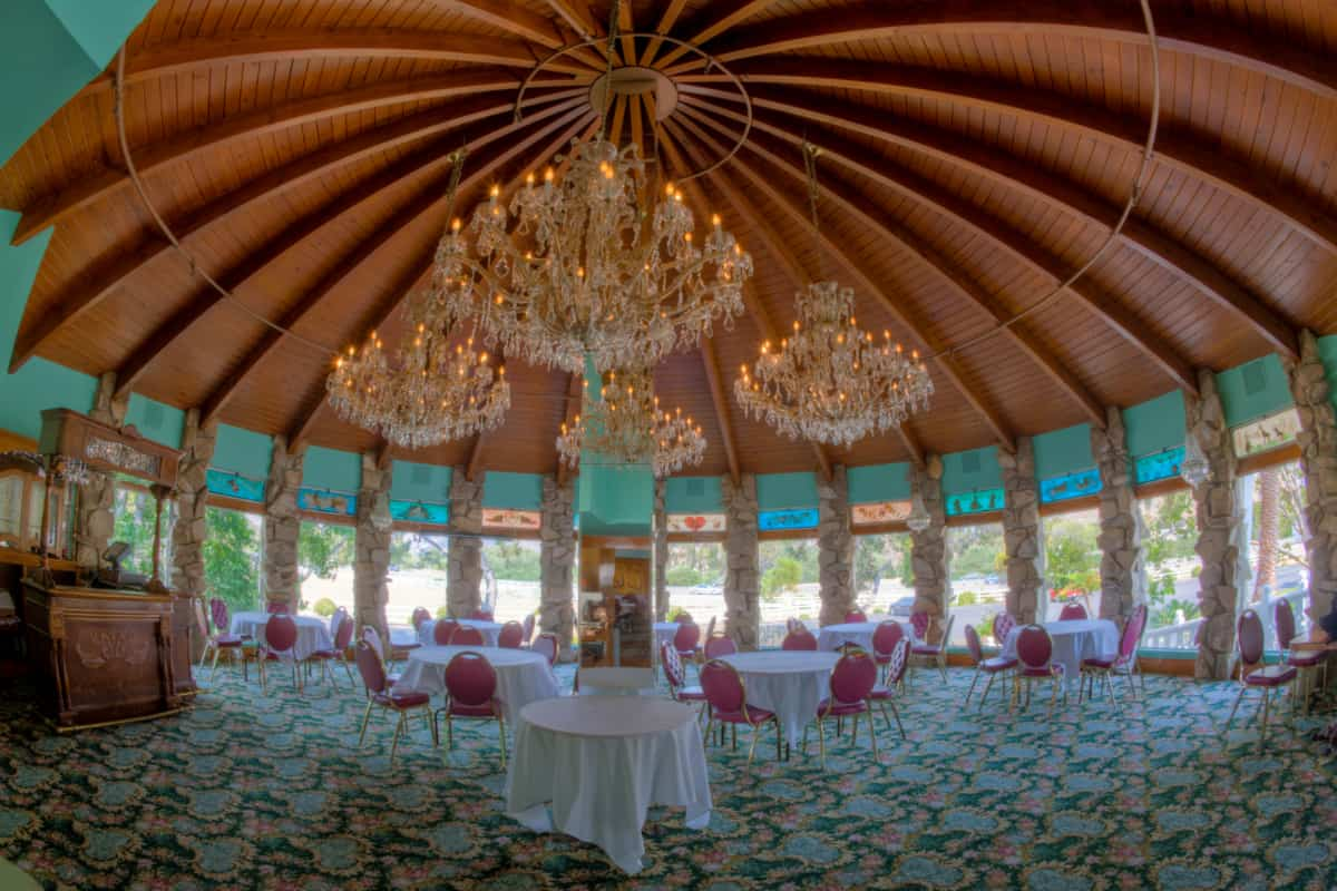 Elaborate dining room, with huge chandeliers hanging from the ceiling