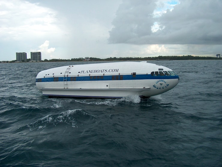 A plane converted into a boat, speeding through the water.