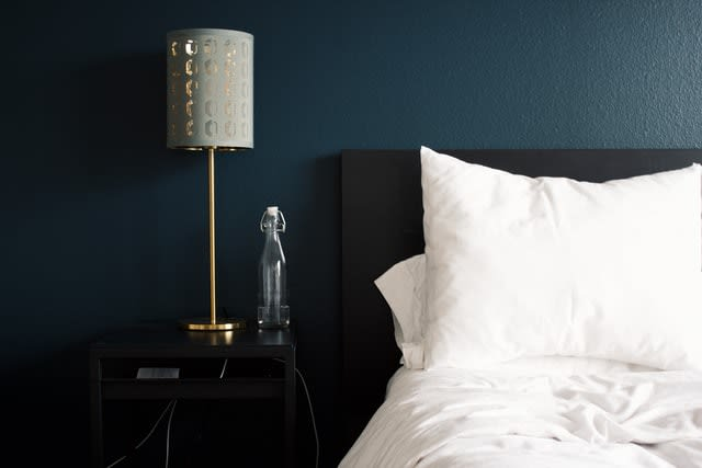 Bed and side table, pillows on bed