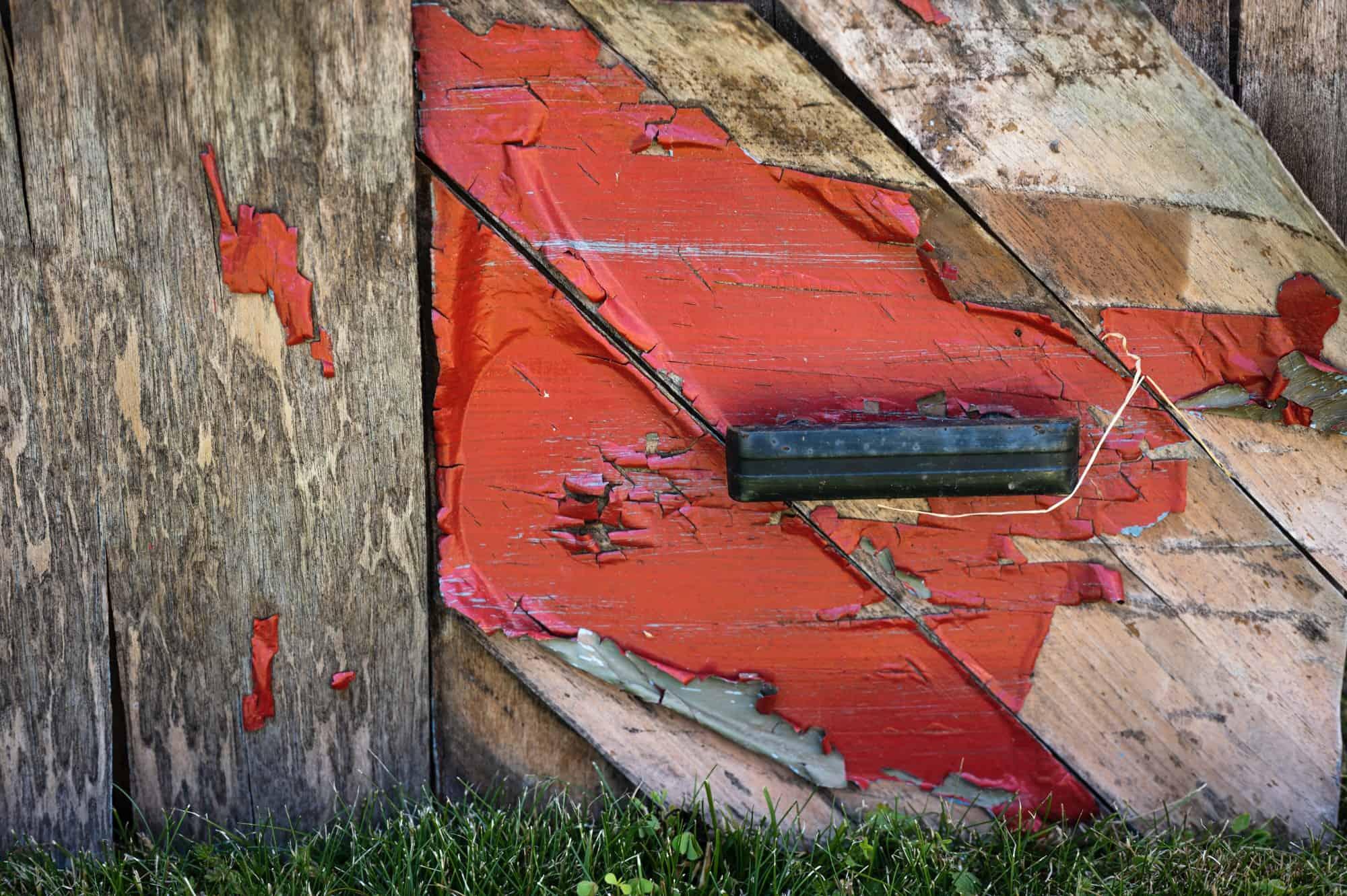 Rustic wooden corner with red paint splash