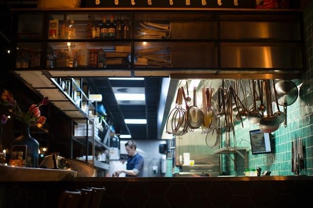 Chef standing in open-air restaurant kitchen