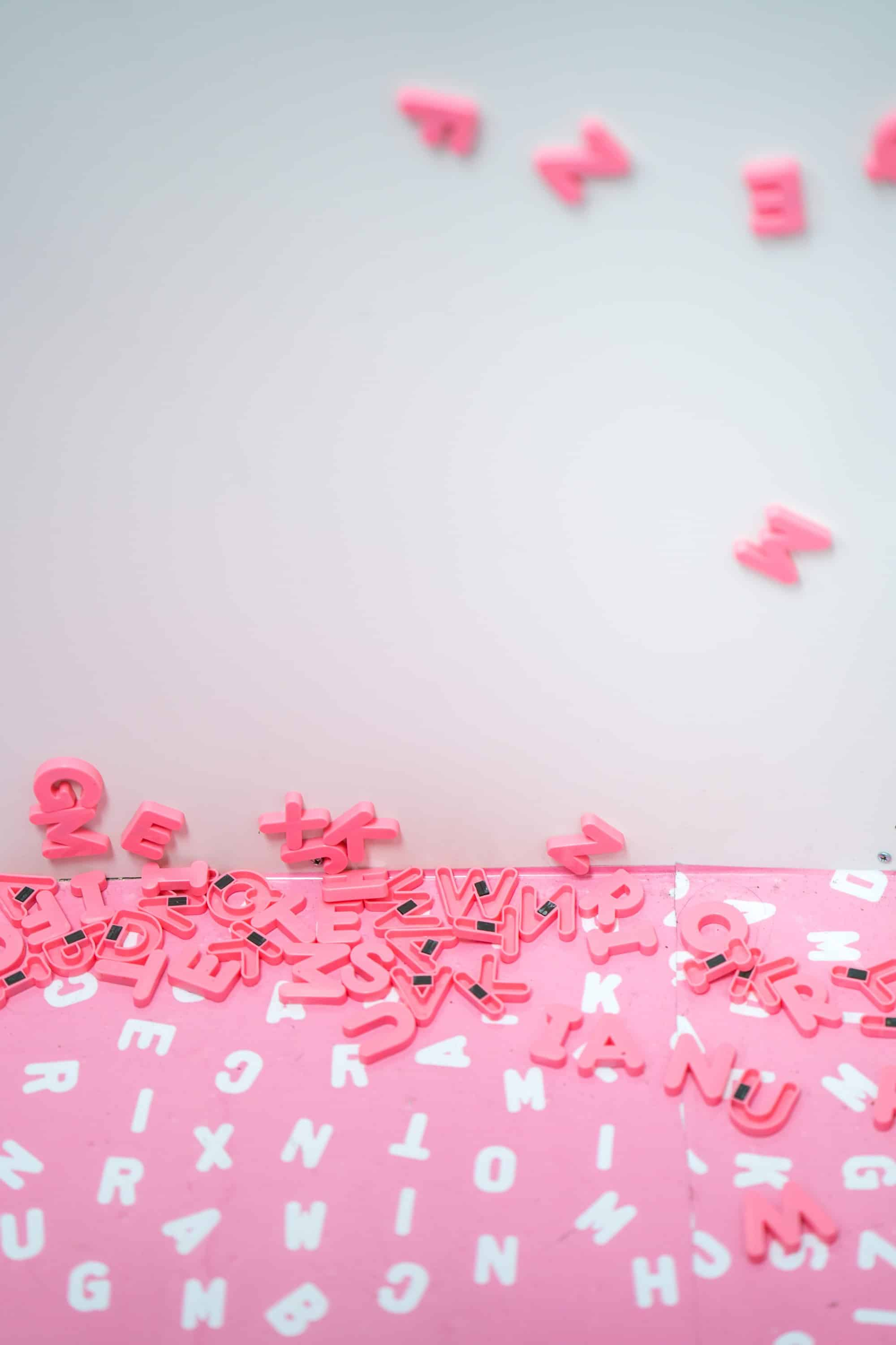 Pink magnetic letters in a pile
